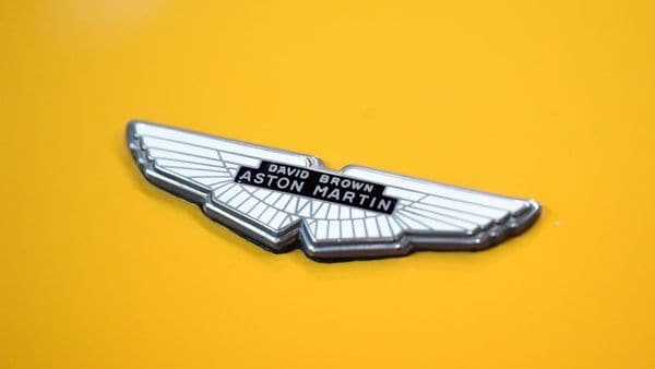 A photograph taken on February 4, 2020 shows the Aston Martin logo on a displayed car during the Retromobile classic car show at Porte de Versailles, in Paris. (Photo by MARTIN BUREAU / AFP) (AFP)