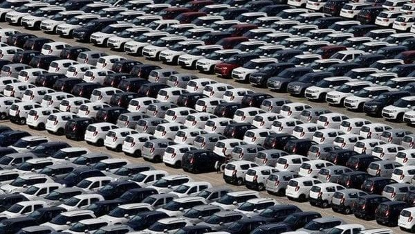 FILE PHOTO: Cars are seen parked at Maruti Suzuki's plant at Manesar, (REUTERS)