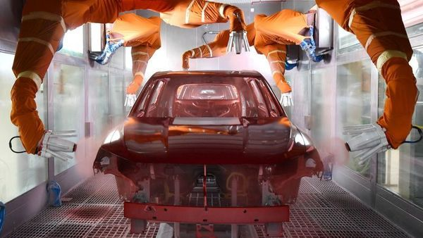 Robotic arms paint a car at the BYD Automobile Company Limited Xi'an plant, in Shaanxi province, China December 25, 2019. The company is now making protective masks. (REUTERS)