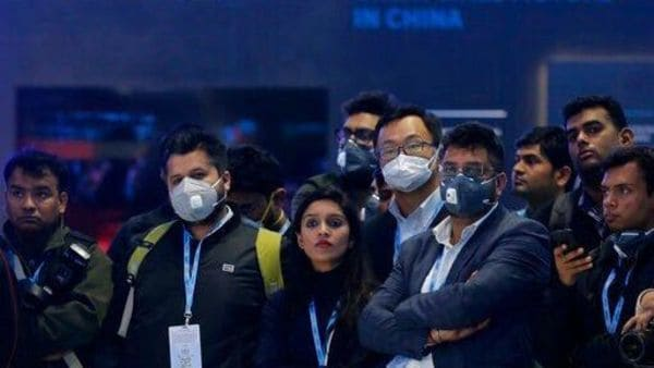 Delegates wear face mask as they attend an event at the Auto Expo in Greater Noida, near New Delhi, India, Wednesday, Feb. 5, 2020. Indian organizers said they were unhappy over the cancellation of more than 296 Chinese delegates and exhibitors who skipped India's biggest auto show due to the outbreak. Visitors at the event were greeted by signs warning against the disease, and many wore masks as they strolled around the exhibition in New Delhi. (AP Photo/Altaf Qadri) (AP)