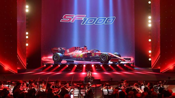This photo taken and handout by the Ferrari Press Office on February 11, 2020 shows a string orchestra perform during the unveiling ceremony of the new Ferrari Formula One SF1000 (C) at Teatro Romolo-Valli in Reggio Emilia. (Photo by Handout / FERRARI PRESS OFFICE / AFP) (AFP)