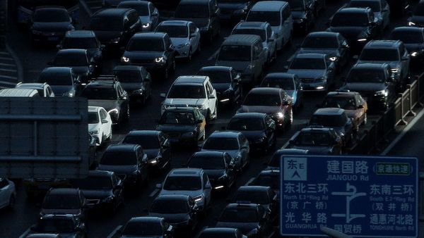 FILE - In this Dec. 11, 2018, file photo, a beam of sunlight is cast on vehicles on a city ring-road clogged with heavy traffic during the morning rush hour in Beijing, China. Auto sales in China have plunged, deepening a painful downturn in the industry's biggest global market and adding to economic pressure as the country fights a virus outbreak. (AP Photo/Andy Wong, File) (AP)
