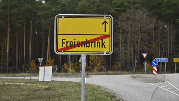 (FILES) This file photo taken on November 13, 2019 shows a place-name sign of Freienbrink, in the municipality of Gruenheide (Mark) of the Oder-Spree county, where Tesla is set to build the new car factory, near Berlin, eastern Germany. - US electric car giant Tesla began clearing forest for its first European