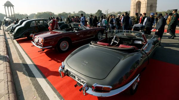 Vintage cars put on display during the 21 Gun Salute International Vintage Car Rally at India Gate, in New Delhi on Saturday. (ANI Photo)