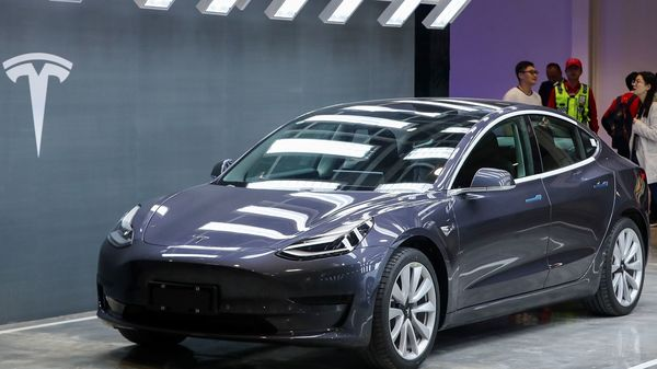 File photo of a Tesla Model 3 car displayed during the Tesla China-made Model 3 Delivery Ceremony in Shanghai. (Photo by STR / AFP) (AFP)