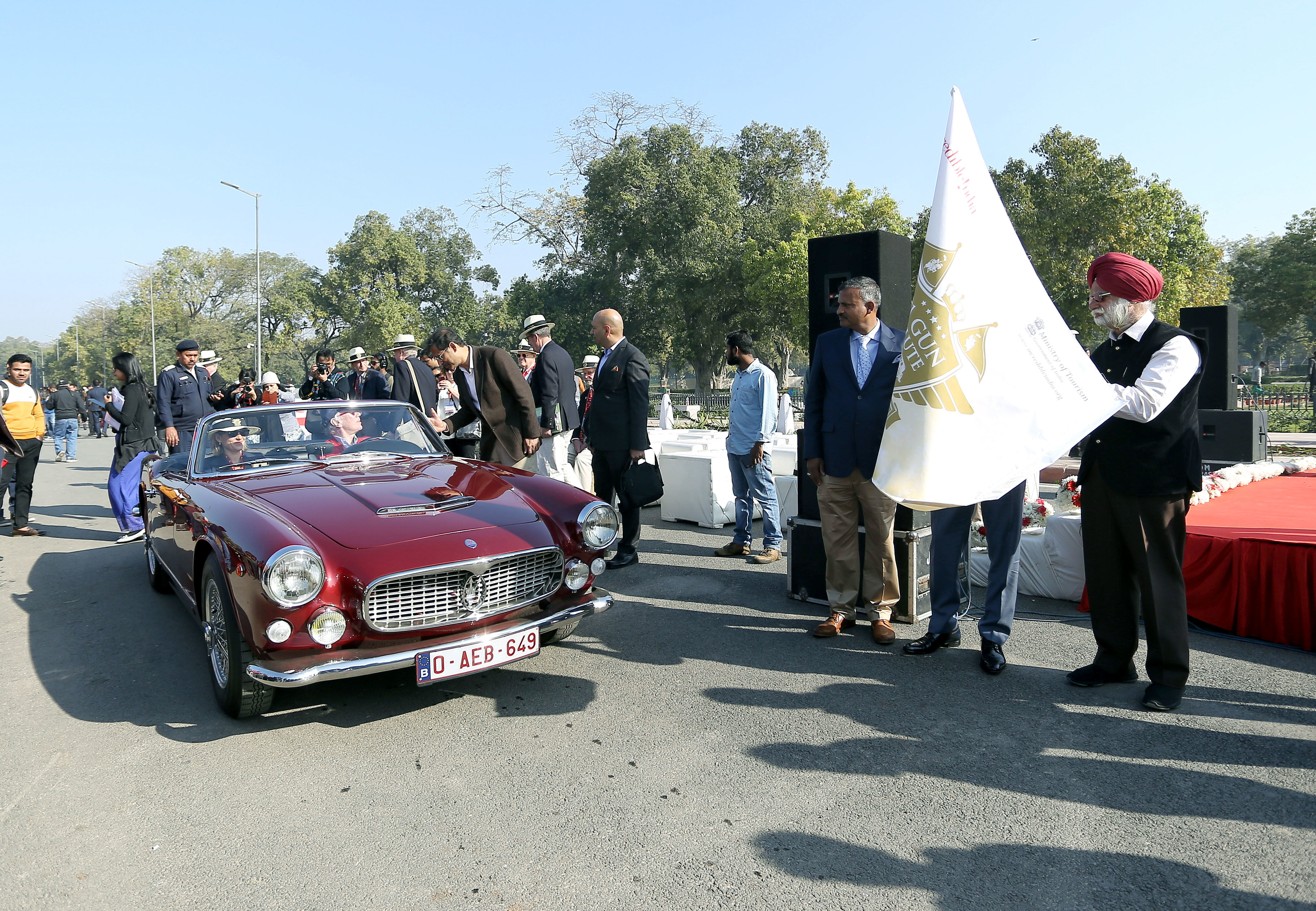 Rajya Sabha MP KTS Tulsi flags off the 21 Gun Salute International Vintage Car Rally, at India Gate, in New Delhi on Saturday. (ANI Photo)