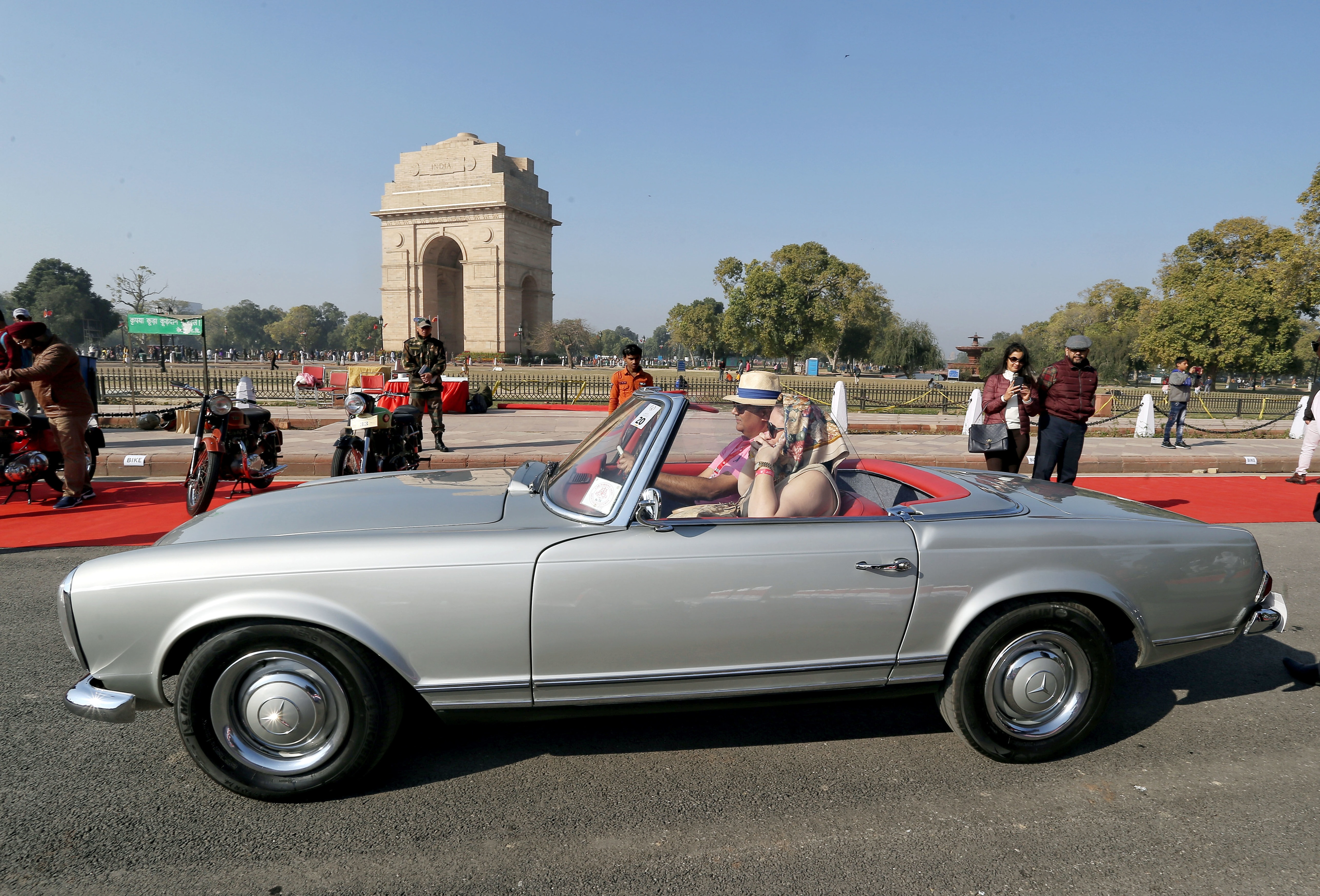 A participant drives the vintage car during the 21 Gun Salute International Vintage Car Rally, at India Gate, in New Delhi on Saturday. (ANI Photo)