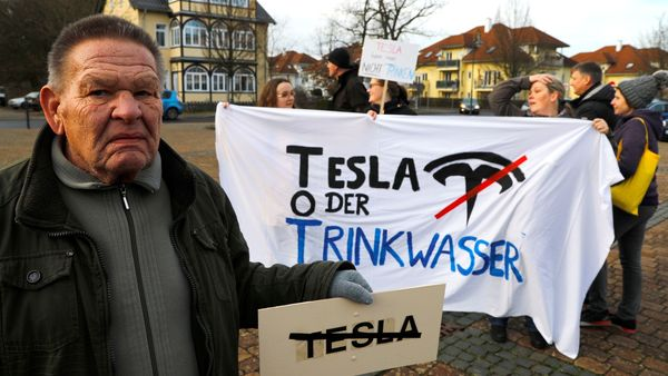 FILE PHOTO: Demonstrators hold anti-Tesla posters during a protest against plans by U.S. electric vehicle pioneer Tesla to build its first European factory and design center in Gruenheide near Berlin, Germany January 18, 2020. REUTERS/Pawel Kopczynski/File Photo (REUTERS)