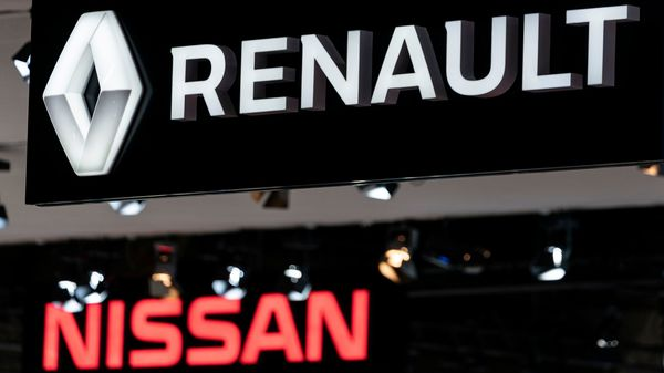 (FILES) In this file photo taken on January 09, 2020 Renault and Nissan automobile logos are pictured during the Brussels Motor Show in Brussels. - French carmaker Renault went into the red last year, the first time in a decade, with net losses of 141 million euros (USD 152 million) due to lower sales and a falling contribution from its Japanese partner Nissan. (Photo by Kenzo TRIBOUILLARD / AFP) (AFP)
