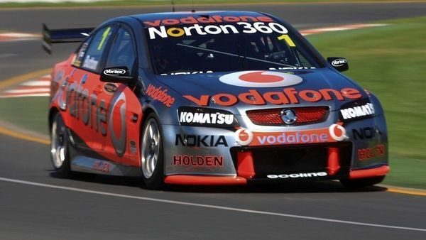 FILE PHOTO: Former McLaren F1 driver Jenson Button drives a Holden Commodore of the Australian touring car series at a promotional event in Melbourne, March 23, 2010. REUTERS/Scott Wensley/File Photo (REUTERS)