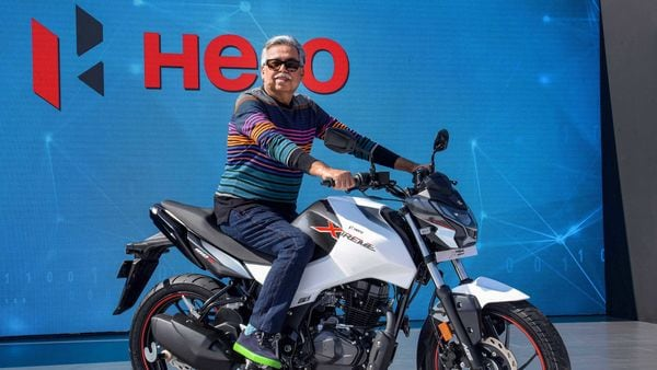 Hero MotoCorp Chairman and Managing Director, Pawan Munjal, unveils the all-new Hero Xtreme 160R bike during Hero World 2020, in Jaipur, Tuesday, Feb. 18, 2020. (PTI Photo) (PTI)