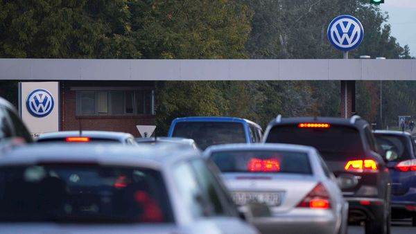 FILE PHOTO: Cars drive through the Sandkamp Gate to the Volkswagen factory in Wolfsburg, Germany. (REUTERS)