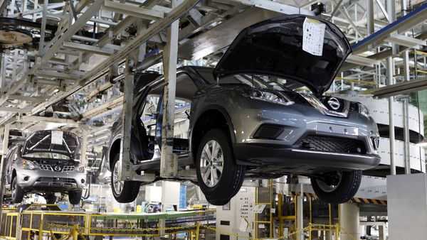 FILE PHOTO: FILE PHOTO: Vehicles of Nissan Motor Co. move on the assembly line at the Kyushu plant in Kanda town, Fukuoka Prefecture, Japan, July 9, 2015. Picture taken July 9, 2015. (REUTERS)