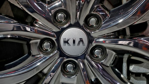 FILE PHOTO: The logo of Kia Motors is seen on a wheel of its Carnival car at the India Auto Expo 2020. (REUTERS)