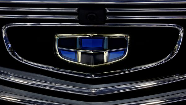 FILE PHOTO: The emblem of the Geely automobile maker logo is seen at the IEEV New Energy Vehicles Exhibition in Beijing, China October 18, 2018. REUTERS/Thomas Peter/File Photo (REUTERS)