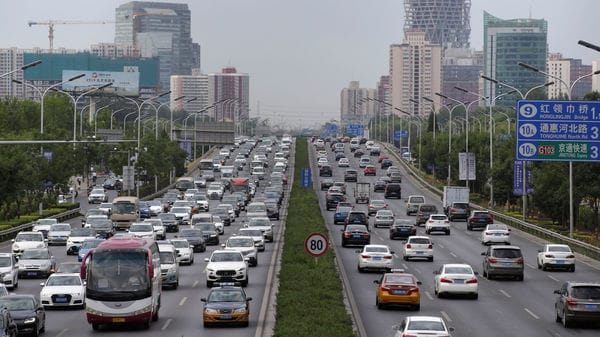 FILE PHOTO: Cars drive on the road during the morning rush hour in Beijing, China, July 2, 2019. REUTERS/Jason Lee/File photo