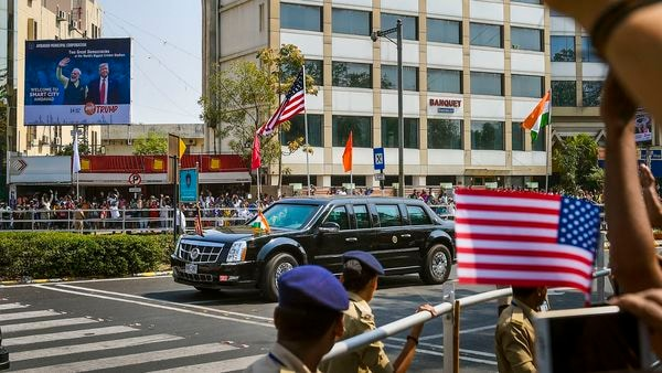 Ahmedabad: People wave as the convoy of U.S. President Donald Trump passes by during the roadshow, in Ahmedabad, Monday, Feb. 24, 2020. PM Modi and U.S. President will participate in a roadshow from the airport to Sabarmati Ashram and from there to Motera cricket stadium for Namaste Trump event. (PTI Photo/Kunal Patil) (PTI)