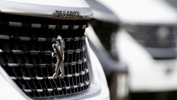The logo of French car manufacturer Peugeot is seen on a car. (REUTERS)