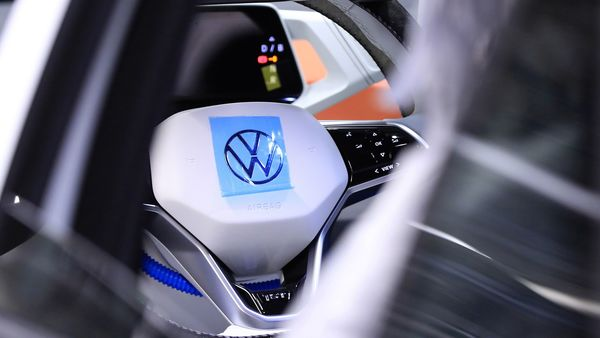 A protective film sits on Volkswagen logo on a VW ID 3 electric automobile steering wheel during final quality checks at the automaker's factory in Germany. (Bloomberg)