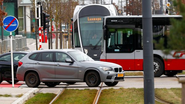 A tram, a bus and cars are pictured at a crossroad in Luxembourg, as it becomes the first country in the world to offer free public transport, February 29, 2020. (REUTERS)