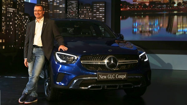 Mercedes-Benz India Managing Director and CEO Martin Schwenk poses with the Mercedes Benz New GLC Coupe. (AP)