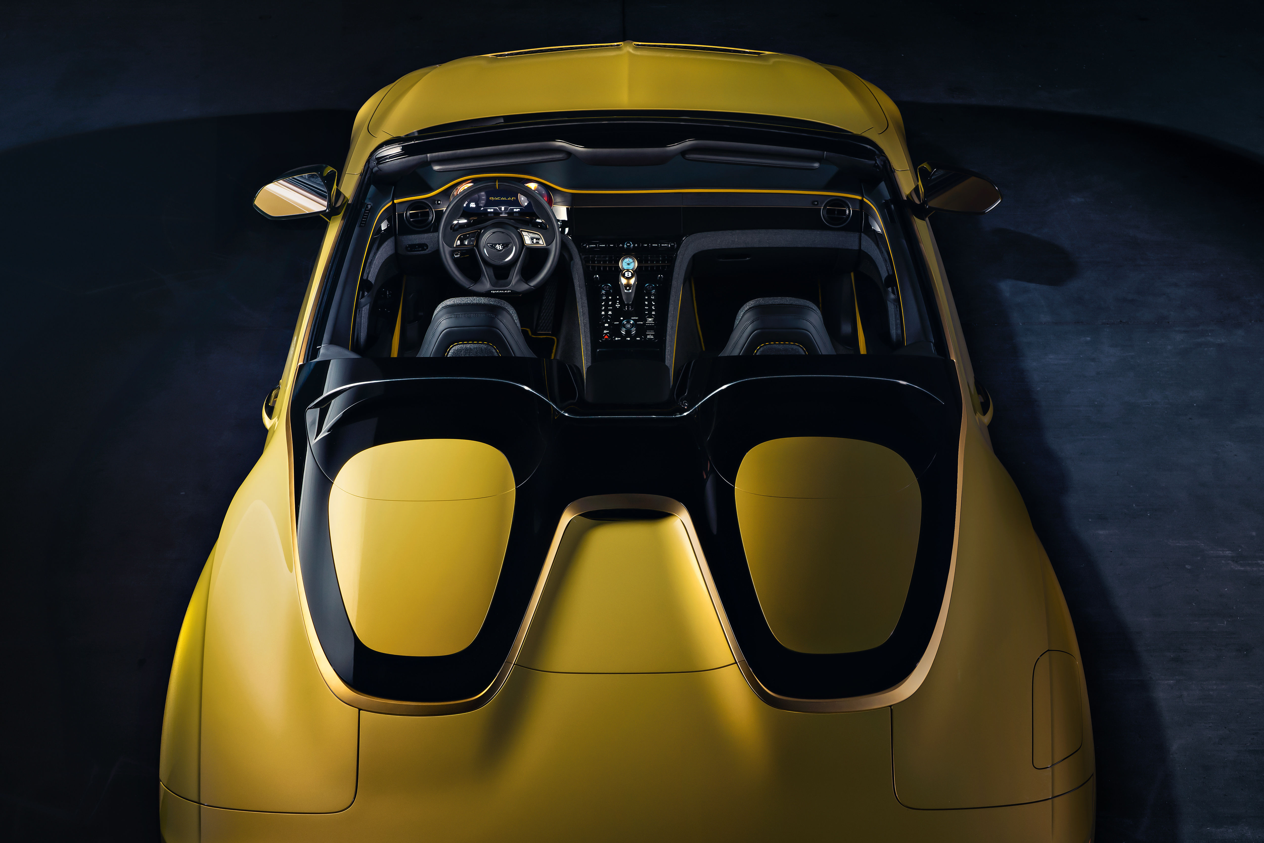 To lighten its weight, the new convertible boasts of two oval-shaped covers on the back of the body.