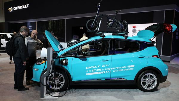 Visitors look at an electric 2020 Chevrolet Bolt at the Canadian International Auto Show in Canada. (REUTERS)