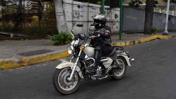 A member of female motorcycle club Ratgirls rides her motorbike along a street in Caracas. (AFP)