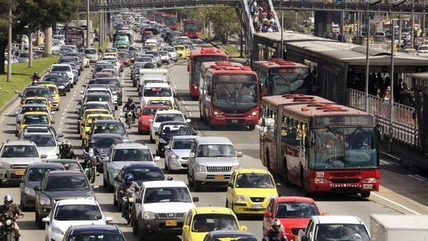 Cars and public buses are seen in a traffic jam along a main street ahead of local elections in Bogota. (REUTERS)