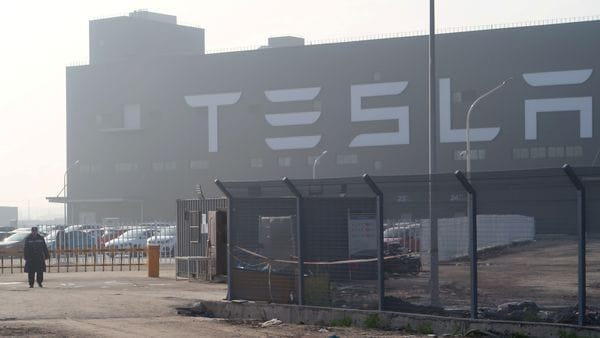 FILE PHOTO: A Tesla sign is seen on the Shanghai Gigafactory of the US electric car maker before a delivery ceremony in Shanghai, China. (REUTERS)