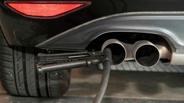 This file photo shows a hose for an emission test being fixed in the exhaust pipe of a Volkswagen Golf 2,0 litre diesel car. (AFP)