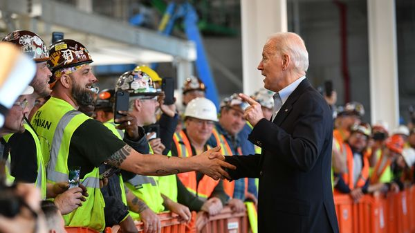Democratic presidential candidate Joe Biden meets workers as he tours the Fiat Chrysler plant in Detroit, Michigan. (AFP)