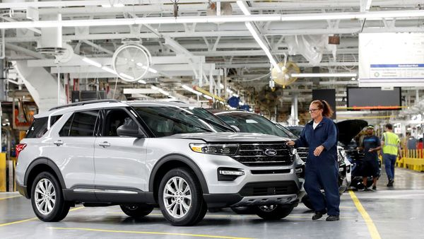 A worker checks a 2020 Ford Explorer car at an assembly plant in Chicago. (REUTERS)