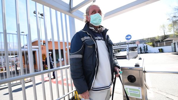 File photo: Fiat Chrysler Automobiles (FCA) worker, wearing a protective face mask, leaves a Mirafiori plant, after the Italian government puts the whole country on lockdown as new coronavirus cases surge. (REUTERS)