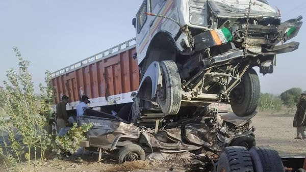 Mangled remains of a car after it collided with a truck in Jodhpur district on March 14, 2020. At least 11 people were killed and three injured in the accident on the Balotra-Phalodi highway. (PTI)