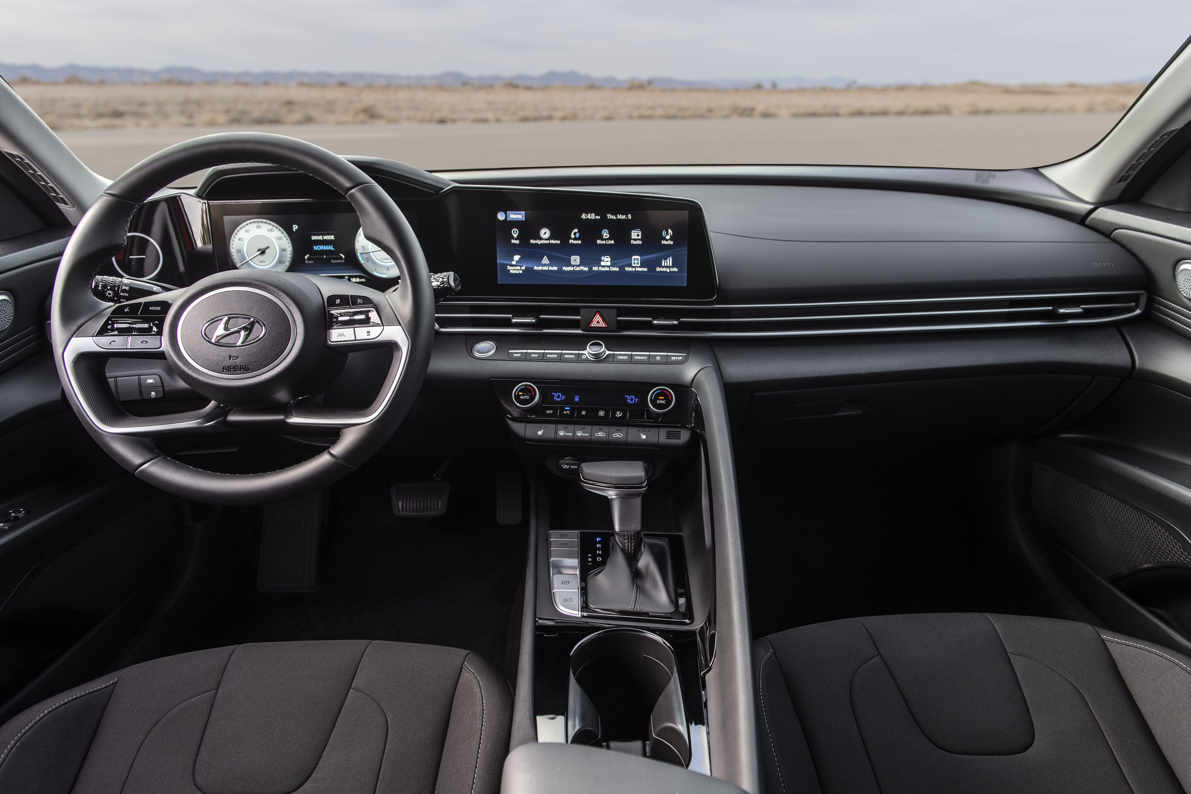 In the 2021 Elantra's cabin, the designer has adopted the idea of 'immersive cocoon' which 'encloses the driver like an airplane cockpit'. The cabin is equipped with a 10.25-inch digital sail instrument cluster and an optional 10.25-inch infotainment system. The latter supports wireless Android Auto and Apple CarPlay wireless which is the first for vehicles in this segment.
