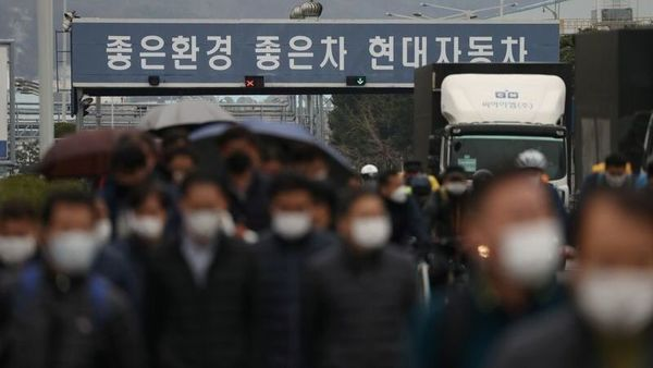 Employees wearing masks to prevent the coronavirus walk at a Hyundai Motors factory in Ulsan, South Korea. (REUTERS)