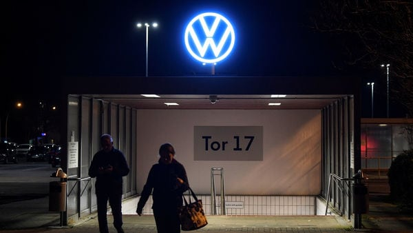 Employees leave the Volkswagen plant after company starts shutting down production in Europe amid the outbreak of coronavirus disease. (REUTERS)