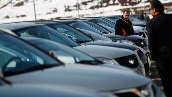 People look at a line of Great Wall Motor cars. (REUTERS)