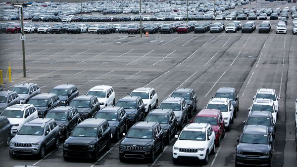 New vehicles sit parked outside the idled Fiat Chrysler Automobiles Jefferson North Plant in Detroit, Michigan. (Bloomberg)