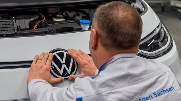 File photo of an employee fixing a Volkswagen sign at a production line of the electric Volkswagen model ID.3 in Zwickau, Germany. (REUTERS)