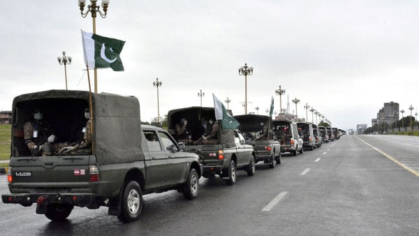 Pakistan's national flags flutter on an army convoy patrolling during a partial lockdown. (REUTERS)