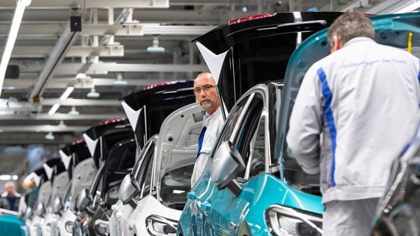 File photo: Employees work at a production line of the electric Volkswagen model ID.3 in Germany. (REUTERS)