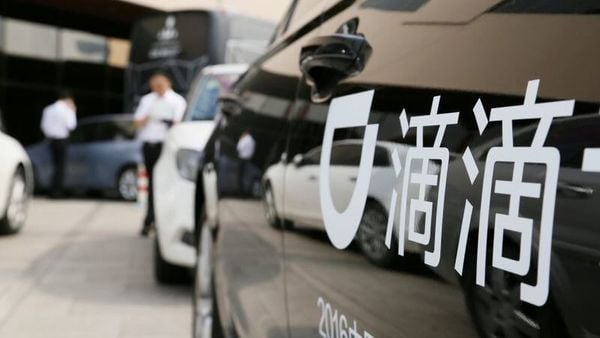 File photo: A Didi sign is seen on a car during the China Internet Conference in Beijing. (REUTERS)