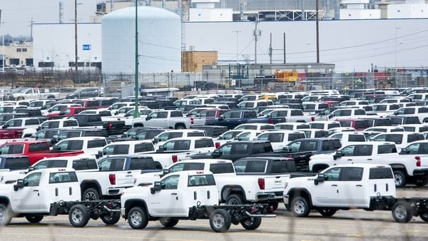 New vehicles sit in a lot in front of the idled General Motors Co. Flint Assembly plant in Flint, Michigan, US. (Bloomberg)