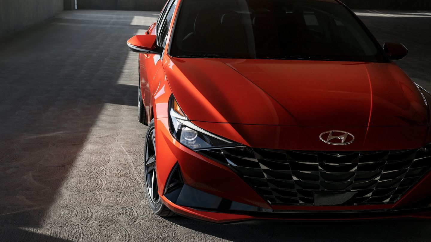 The turn signal lights in the all-new Elantra are integrated into the grille and are next to large headlights.