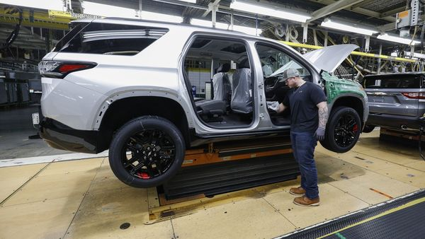 A General Motors worker is shown on the assembly line at the General Motors Lansing Delta Township Assembly Plant. (AFP)
