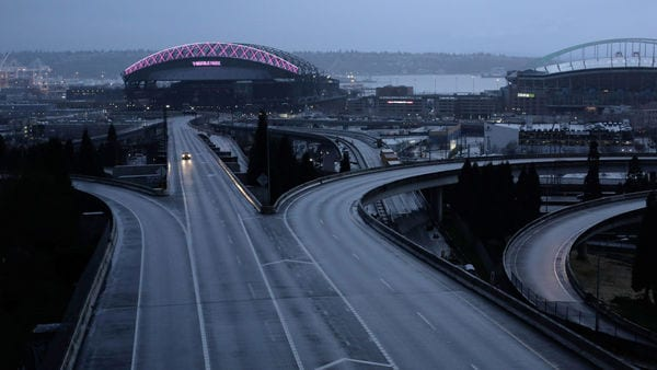 A car moves along an empty highway during the coronavirus disease (Covid-19) outbreak in Seattle, Washington, US. (REUTERS)