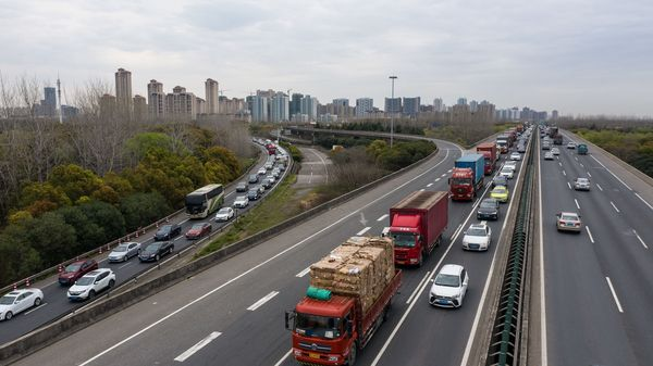 File photo: Freight trucks and other vehicles travel on a highway in this aerial photograph taken in Shanghai, China. (Bloomberg)