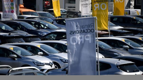French vehicle brand Renault are parked in Paris on March 26, 2020, on the tenth day of a lockdown aimed at curbing the spread of Covid-19. (AFP)